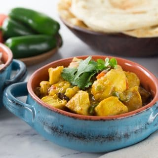 Bring some exotic flavors to your home with this easy to make dish. You will love this spicy, tender and sweet chicken xacuti recipe. This dish is has lots of flavors and includes turmeric, star anise, ginger, cardamom, chili powder, coriander, tamarind juice and fenugreek. This makes a really tender and delicious stewed chicken dish with a creamy and spicy sauce. This is great when served with basmati rice or naan bread. | ethnicspoon.com