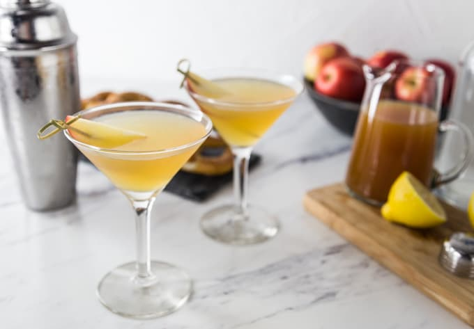 Apple season is here and it's time for a tasty fall cocktail. Try this citrus apple cider martini with rosemary infused simple syrup. You will love the sweet, tart and herbal tones in this drink. You can make up a batch of the rosemary simple syrup and keep it on hand for other cocktails. Try it in salad homemade dressing for a little sweetness and rosemary flavor. Shake up this cocktail at your next happy hour! | ethnicspoon.com