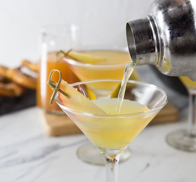 I love visiting our local cider mill to pick up some fresh cider and it's time for a fall cocktail! Try this citrus apple cider martini with rosemary infused simple syrup. You will love the sweet, tart and herbal tones in this drink. You can make up a batch of the rosemary simple syrup and keep it on hand for other cocktails. Try it in salad homemade dressing for a little sweetness and rosemary flavor. Shake up this cocktail at your next happy hour! | ethnicspoon.com