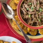 Do you love Cuban food? Here is one of my all-time favorite Cuban dishes and you can make this in the slow cooker. You will love this tender, juicy Cuban ropa vieja beef roast. You have to serve this with a side of black beans and fried plantain too! This is a very easy dish to make and has some great flavors plus it freezes well so make a big batch! | ethnicspoon.com