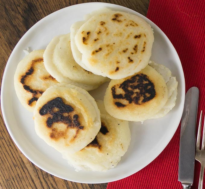a plate of fried arepas