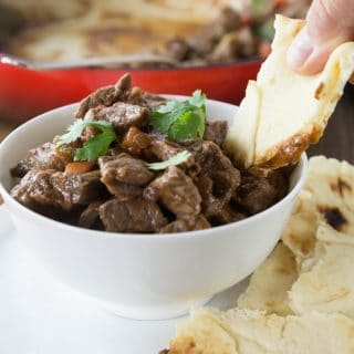 Try this fantastic dish from Kashmir that has its origins from Persia. Spicy and rich rogan josh is an easy Indian dish to prepare in your dutch oven or slow cooker. The mixture of spices is what gives this amazing spicy lamb stew its deep, rich, and aromatic taste. I used my homemade garam masala as well as other spices. You will want to have lots of naan bread for dipping into this tasty sauce. If you like curry dishes you will love this dish. | ethnicspoon.com