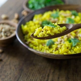 How about an exotic rice dish from Indonesia. Indonesian turmeric rice (nasi kunci) with coconut milk and cashews has such delicate flavors you will be amazed how delicious this humble dish is. You can also garnish with cilantro, coconut flakes, and crispy fried onions. #indonesianfood #nasikunci #turmeric #healthyrecipe # turmericrice | ethnicspoon.com