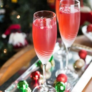 Try a crisp and refreshing prosecco pomegranate mimosa! Sparkling bubbly prosecco with a splash of tang pomegranate is a tasty combination for this libation. | ethnicspoon.com