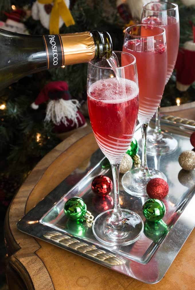 Here is a wintry twist on a classic brunch cocktail. Try a crisp and refreshing prosecco pomegranate mimosa! Sparkling bubbly prosecco with a splash of tang pomegranate is a tasty combination for this libation. | ethnicspoon.com