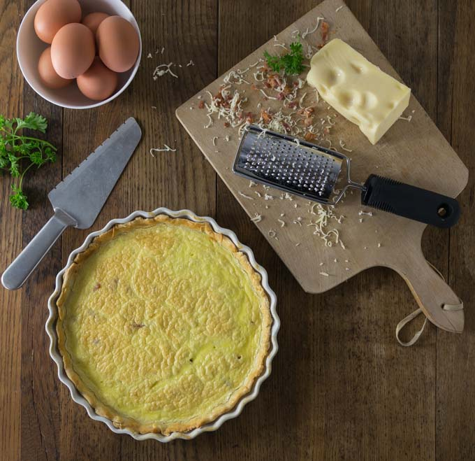 Try a classic dish with simple ingredients of eggs, bacon, cream and cheese that come together in a crispy crust. Quiche Lorraine is a slice of goodness and you will love the flavor! This is a dish for all meals: breakfast, brunch, lunch or dinner. | ethnicspoon.com
