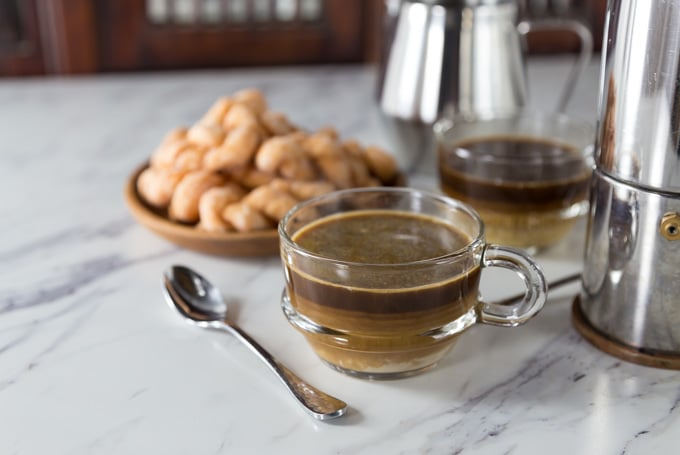 You can make this coconut coffee creamer at home and use it with your coffee fix. Vietnamese coconut coffee is a super simple coffee drink to make at home and it is the authentic version made in Hanoi at popular coffee shops. Drizzle in a combination of sweetened condensed milk and coconut cream on top of a strong brewed coffee. | ethnicspoon.com