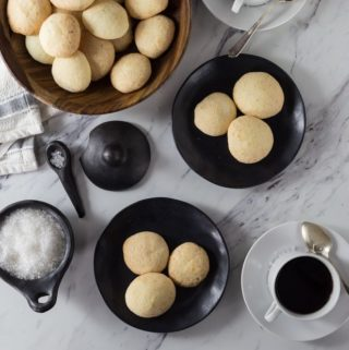 Brazilian cheese bread or pão de queijo is a tasty bite of comfort food. You will want to these warm out of the oven but you can reheat them too. They have a nice crunchy exterior and soft cheesy middle. | ethnicspoon.com