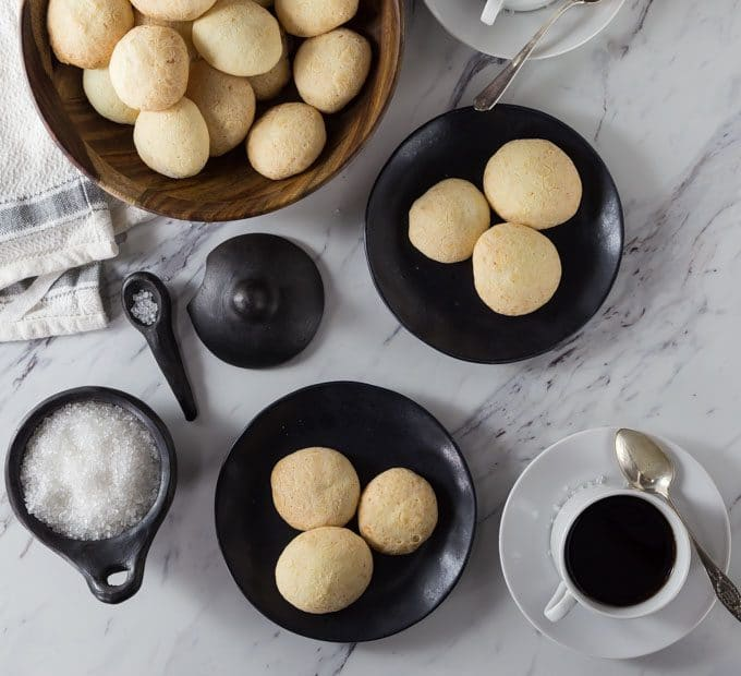 Brazilian cheese bread or pão de queijo is a tasty bite of comfort food. You will want to these warm out of the oven but you can reheat them too. They have a nice crunchy exterior and soft cheesy middle.   ethnicspoon.com