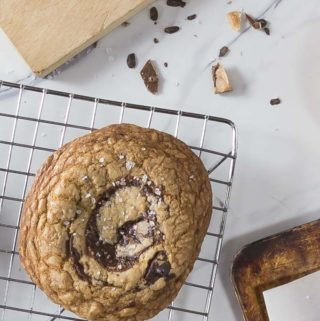 Chocolate lovers will absolutely love this cookie! You might like chocolate chip cookies but this English toffee, brown butter chocolate chunk cookie with sea salt is nothing short of amazing! Trust me this needs to be on your bucket list of things to bake. | ethnicspoon.com