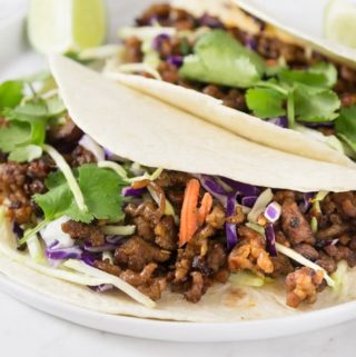 Here is a quick and easy weeknight meal for taco Tuesday made with ground pork. Spicy pork tacos with red cabbage slaw made with Vietnamese chili garlic sauce have a nice kick of heat you will love. The spicy flavors along with some ginger, brown sugar and cinnamon add a nice depth. These have the right amount of spice and a nice crunch too! | ethnicspoon.com