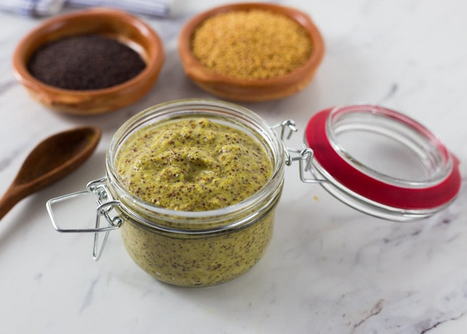 Buy some mustard seeds and soak them to make your own homemade mustard. Homemade mustard is so easy and you can explore new flavors too! Try this Irish cider tarragon mustard on some sausages or roast beef! This spicy whole grain pungent mustard is not for the faint of heart. You will enjoy the kick this brings but also has some subtle flavors too! | ethnicspoon.com
