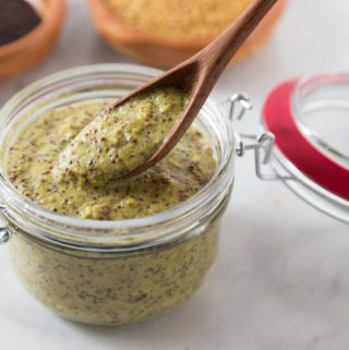 Homemade mustard makes a big batch so you can share it with friends. Buy some mustard seeds and soak them to make your own homemade mustard. Homemade mustard is so easy and you can explore new flavors too! Try this Irish cider tarragon mustard on some sausages or roast beef! This spicy whole grain pungent mustard is not for the faint of heart. You will enjoy the kick this brings but also has some subtle flavors too! | ethnicspoon.com
