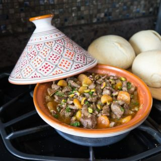 Moroccan lamb tagine with its combination of sweet and savory flavors is one dish that is hard to resist and easy to make too. You can make this in the slow cooker, dutch oven or tagine dish. | ethnicspoon.com