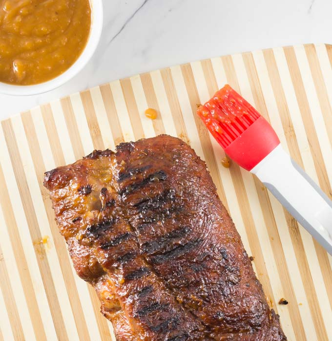 During grilling season I love to experiment with homemade BBQ sauces and I think you will love this one. My sweet and spicy peach bourbon sauce has a nice combination of flavors. Brush some on your rack of ribs while grilling and dip them when they are done! | ethnicspoon.com