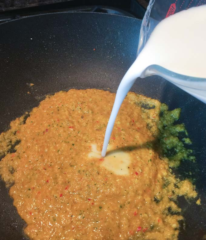 Add coconut milk step to the curry paste for your chicken amok.