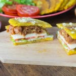 A photos of a jibarito sandwich on a cutting board.